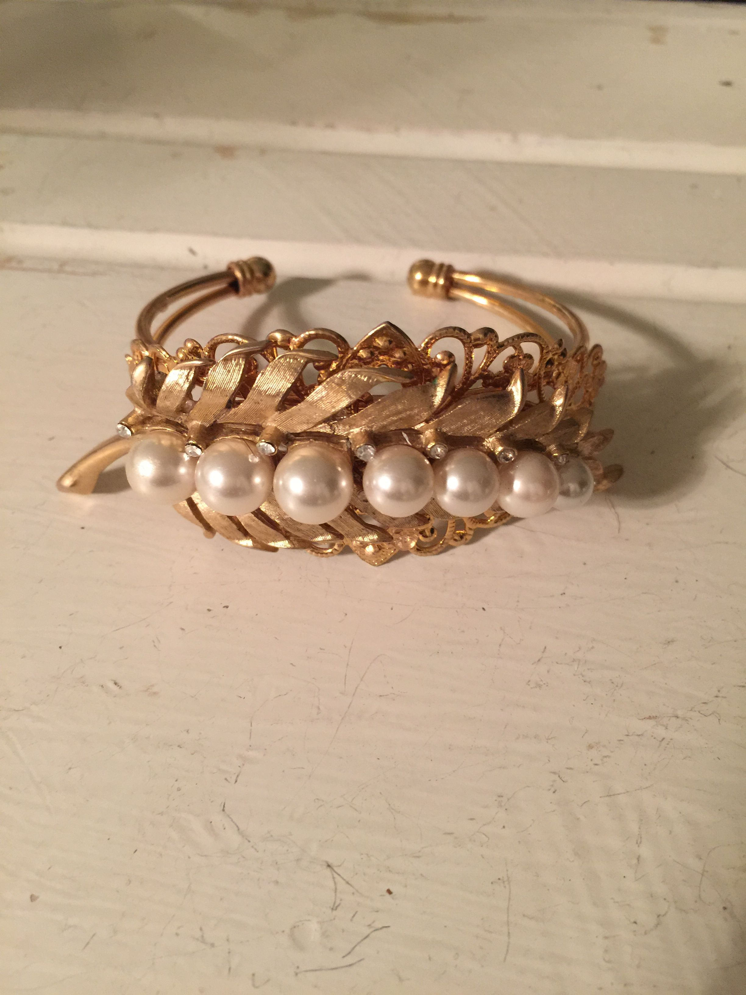 This cuff bracelet is super fun,  I took a vintage brooch and added it to a new filigree cuff bracelet.  The bracelet it very adjustable so it will fit your bf when she wants to borrow it since it is one of a kind!  - $26.99