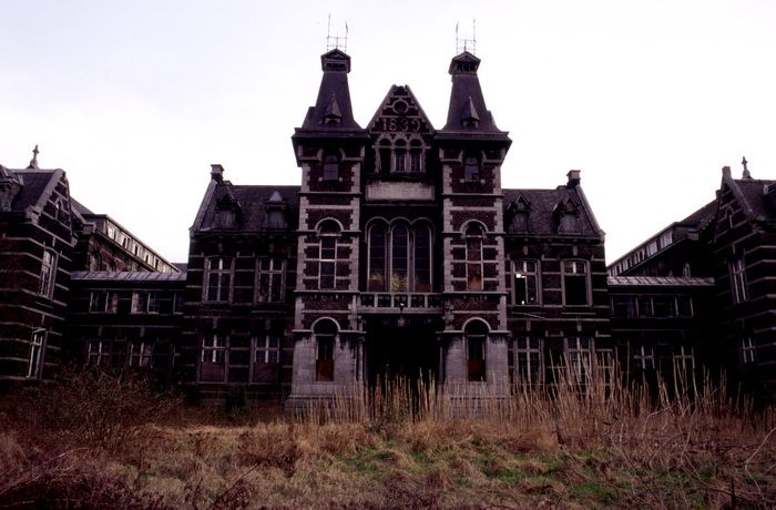 """La Valdor Liege The old hospital """"Le Valdor"""" was built in 1889. The castle-like building hides a huge monastery with kilometers of paths through corridors, cellars and attics. Although the building is completely empty, except for a number of chairs, it is still possible to recognize the sister/nurse dormitories, waiting rooms, offices, laboratories, consultation and operating rooms.    Update: Renovations on the building started in 2008."""