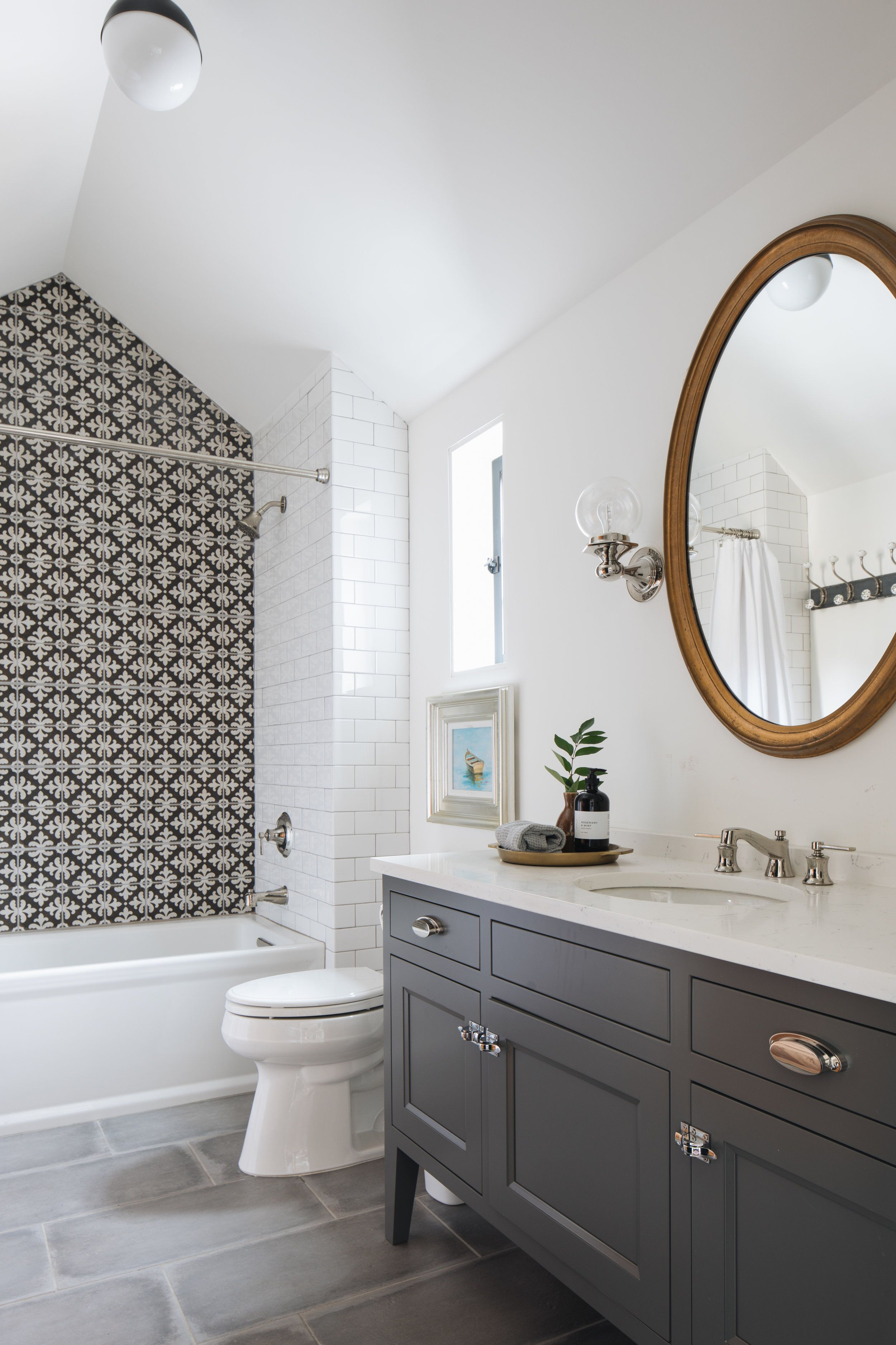 Bathroom With Vaulted Ceiling Feature Tile Sconces Vanity On