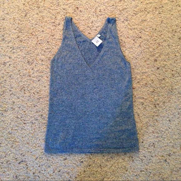 AX top metallic blue M (runs small) Worn a few times. Almost new Armani Exchange Tops