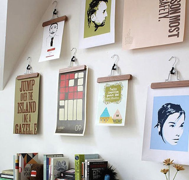 creative way to hang pictures would work great for erins room spray paint the hangers to match. Black Bedroom Furniture Sets. Home Design Ideas