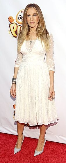 All laced up! SJP teamed a dotted LWD, shimmering glitter heels, and chunky bracelets to present at the NYC event.