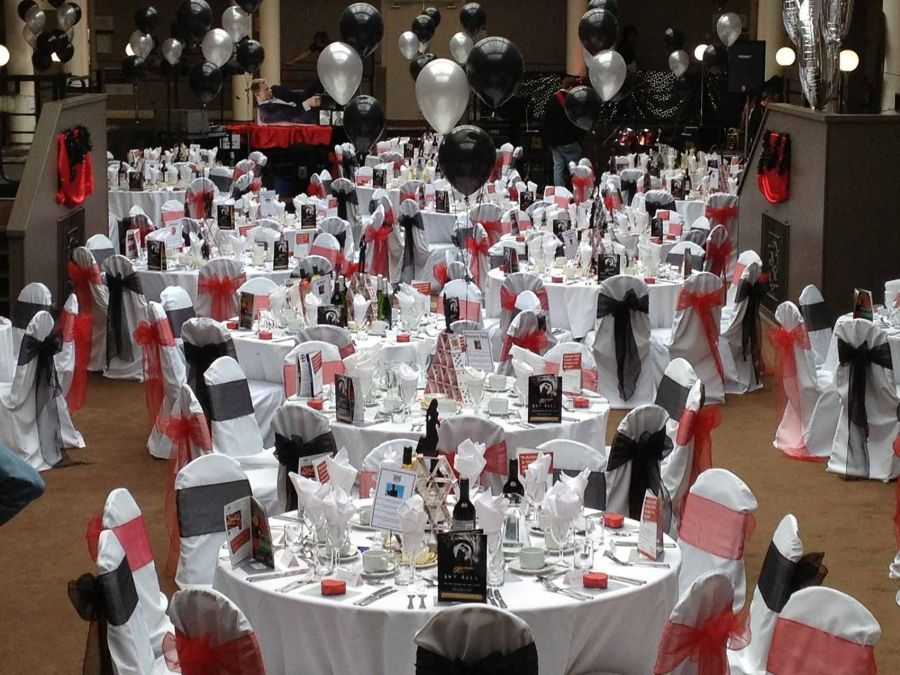 James bond themed event balloons and pops of red 007 for 007 decoration ideas