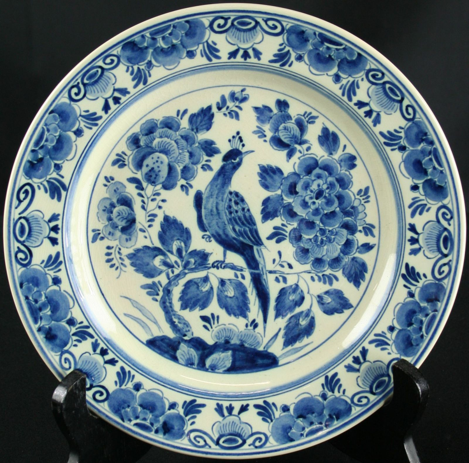 Vintage blue plate with peacock