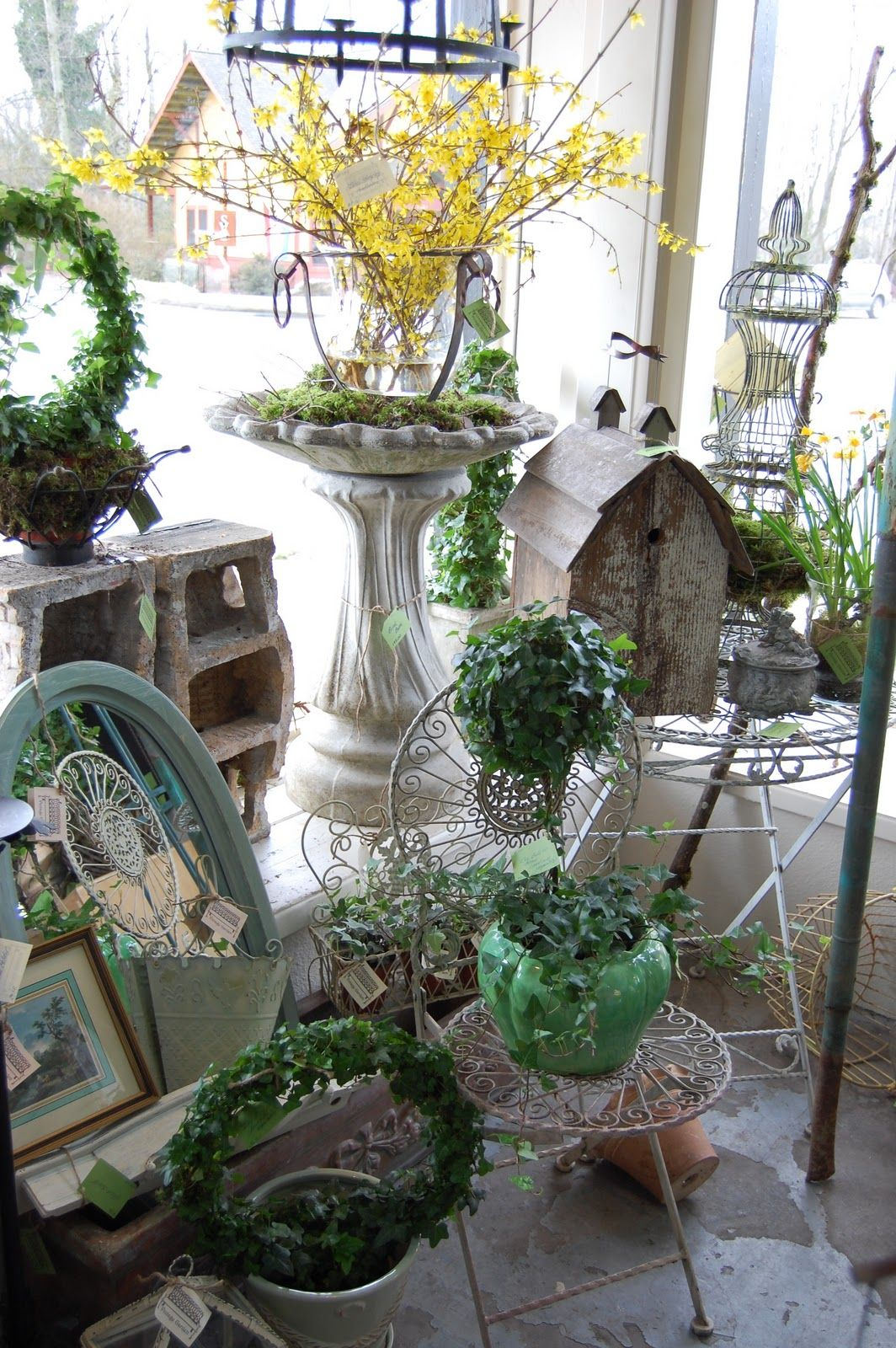 I am really liking the use of plants and greenery in ...