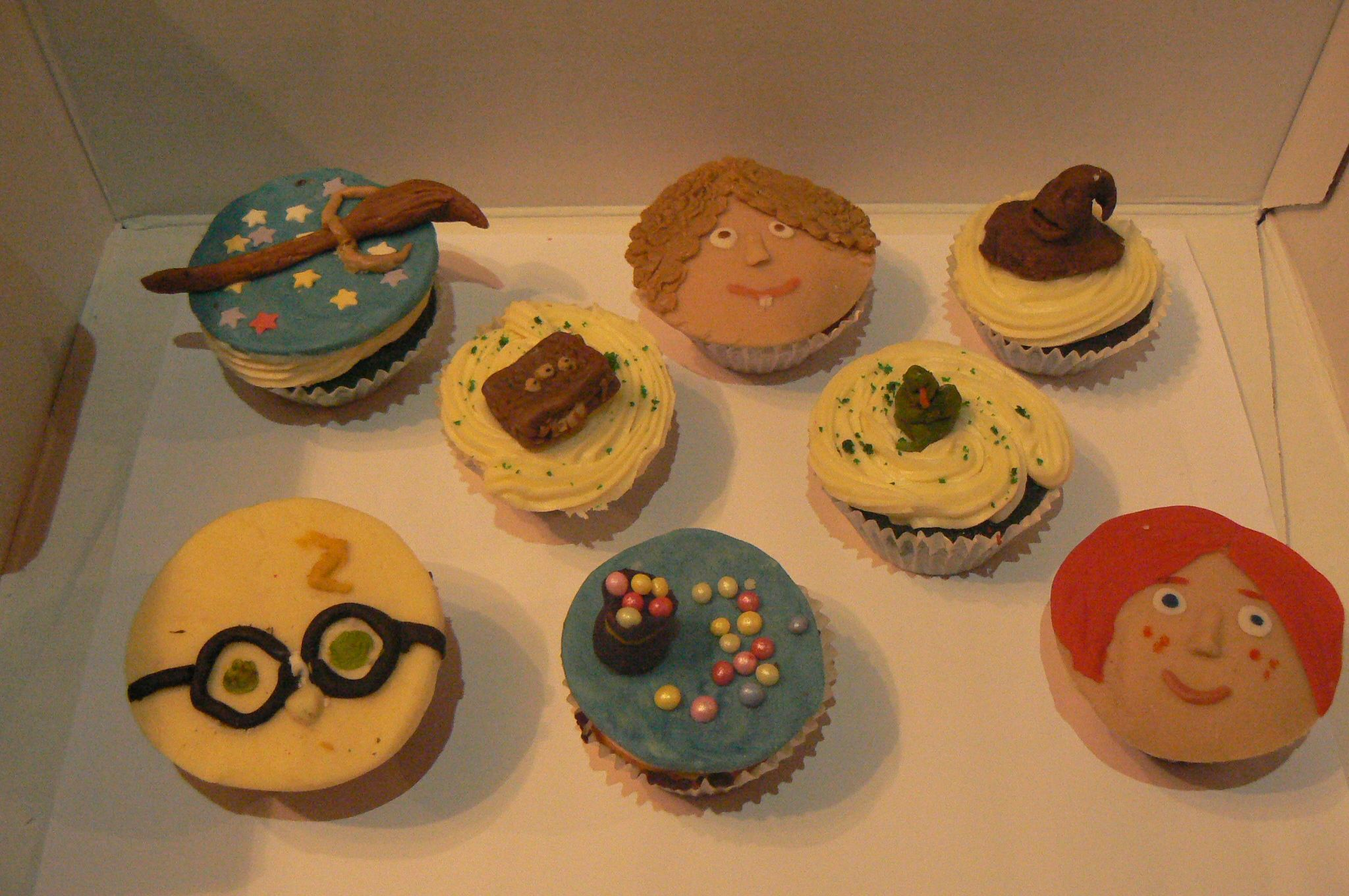 my harry potter cupcakes, made of modelling chocolate. each cupcake is also coloured for the houses.. :)
