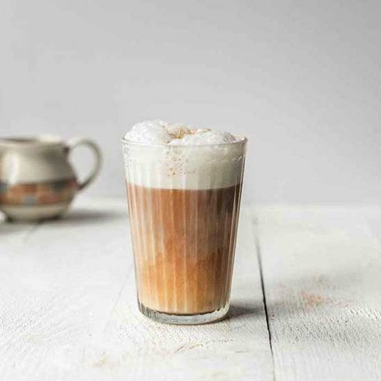 Vegan latte macchiato coffee made with almond milk and strong espresso. #lattemacchiato