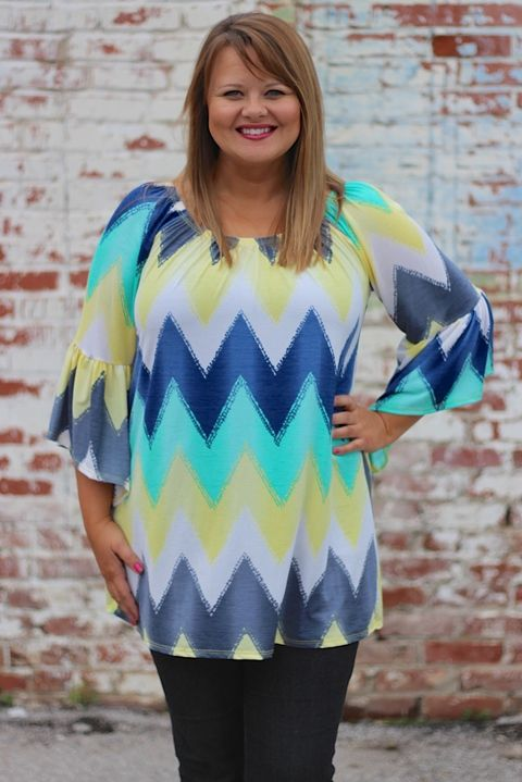"Our Sunshine Yellow & Blue Chevron Tunic with Bell Sleeves is made of 92% Polyester and 8% Spandex and measures approximately 31"" long from shoulder to hem.  This tunic is available in sizes 12-18."