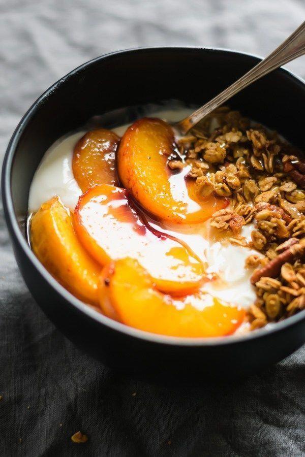 Peach Crisp Yogurt Bowls - Made with creamy vanilla yogurt, homemade maple granola, and juicy roasted peaches. Enjoy this for breakfast or a lightened-up dessert! |