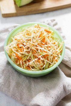 and easy apple cider vinegar coleslaw with shredded cabbage and carrots. Flavorful, healthy and mayo-free.