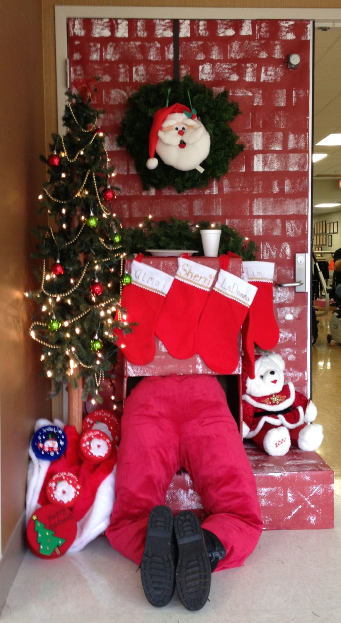 Santa in fireplace. Santa in chimney. Door decoration