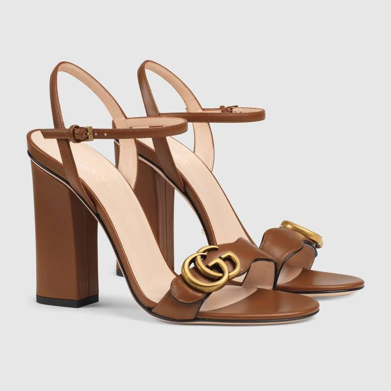 60d3f864d7d Shop the Leather Double G sandal by Gucci. An emblem of the GG Marmont  line