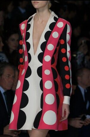 bold black, red, orange, pink and white sharply tailored sixties style dress
