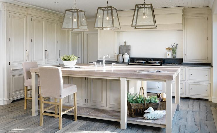 gorgeous kitchen boasts cream cabinets adorned with aged brass rh pinterest com
