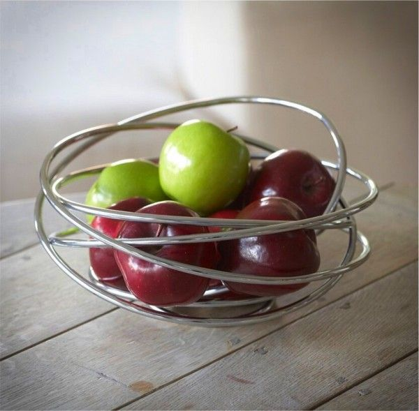 A handcrafted fruit bowl made from a single piece of free flowing steel wire it will add a piece of sculpture to any table and is ideal for holding fruit