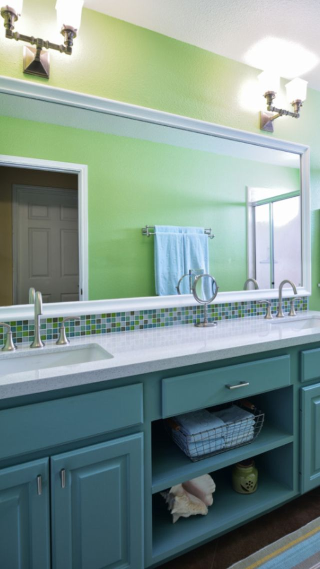 Guest bath where shelves were add to enclose open vanity By Laura