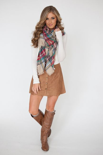 802d196bde Faux suede skirt with front button detail and scalloped bottom hem. 100%  polyester. Fits true to size.