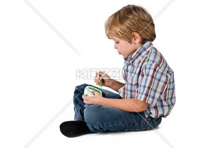 side view of a boy playing video game. - Side view of a boy playing video game over white background.