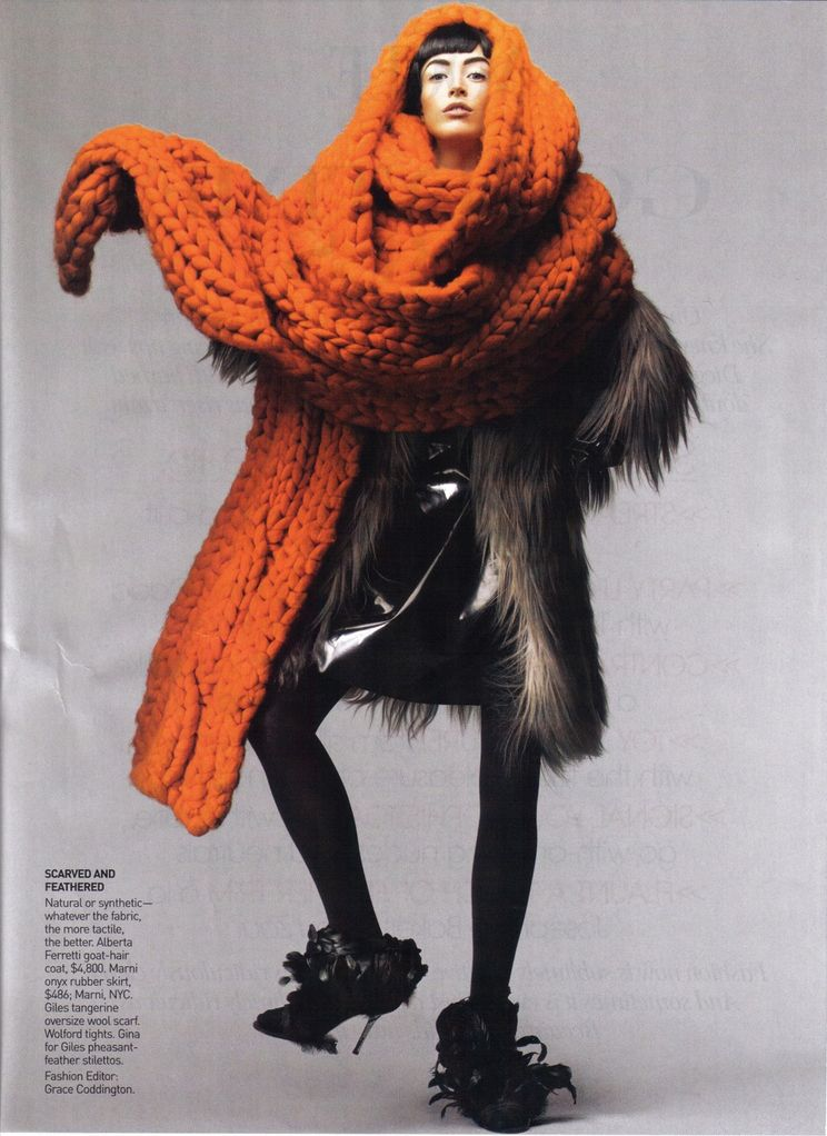 """Fashion editorial by Grace Coddington built around this magnificent bittersweet orange hand knit scarf.   FYI: """"If Wintour is the Pope . . . , Coddington is Michelangelo, trying to paint a fresh version of the Sistine Chapel twelve times a year,"""" Time magazine said in 2009. More on the incredible life of Grace Coddington http://www.vogue.com/voguepedia/Grace_Coddington"""