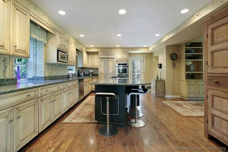 I am in love with that buttermilk color cabinets   Custom ...