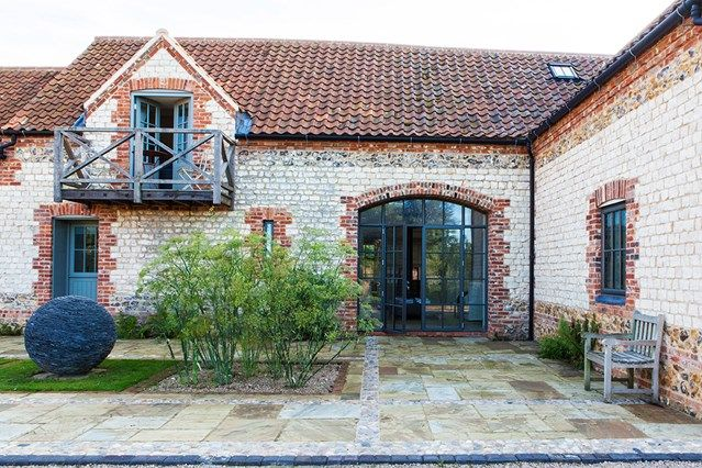 Courtyard - A secluded modern yet characterful barn conversion in Norfolk created by Clare Agnew as her family home - Real Homes on HOUSE by House & Garden.