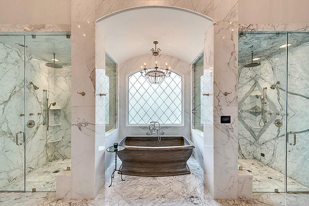 Bookmatched Calacatta Marble Walls Surround The Two Seamless His U0026 Hers  Glass Showers. One Of The Showers Is Equipped W/ Steam Fixtures.