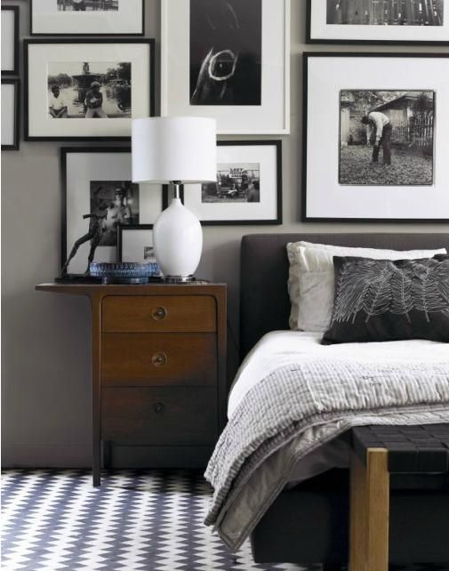 Classic #gallery wall - mixing black & white gallery frames. Looks like they've filled the wall – right down to the headboard.