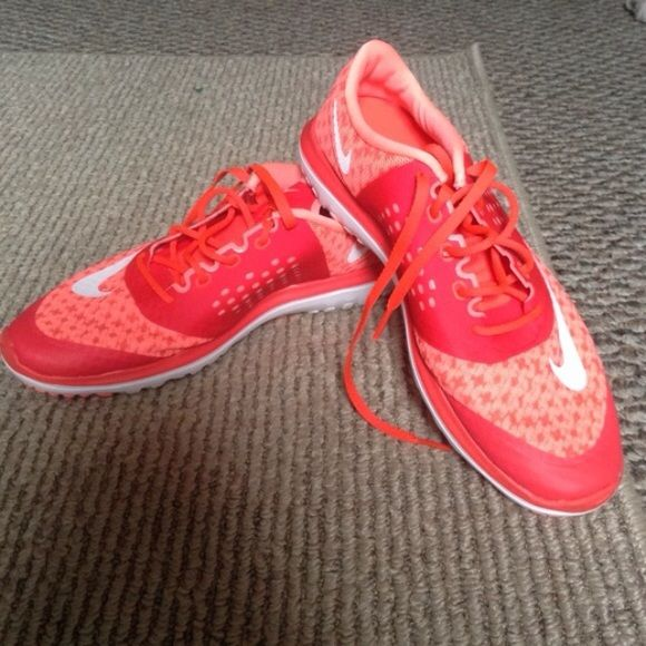 9034c6c533e4 Coral Pink Nike Fitsole Sneakers Only wore a couple times. Other than being  a