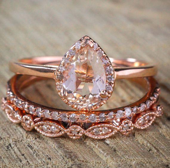 on 225 carat Pear shape Morganite and Diamond Halo Trio Bridal