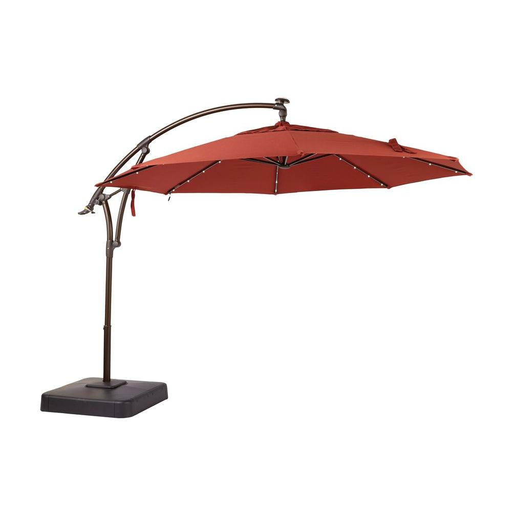 Hampton Bay 11 Ft Led Round Offset Outdoor Patio Umbrella In Sunbrella Henna Yjaf052 C The Home Depot In 2020 Sunbrella Patio Offset Patio Umbrella Patio Umbrella