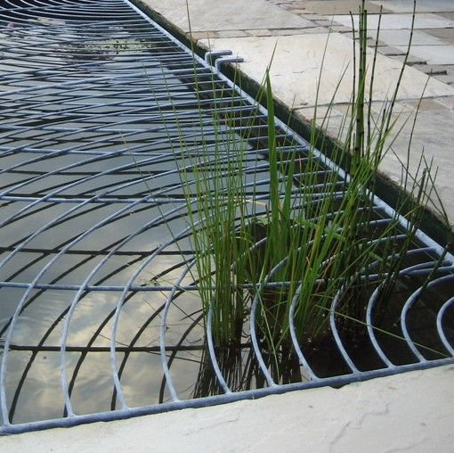 Contemporary ripple design metal pond cover james price for Decorative fish pond covers