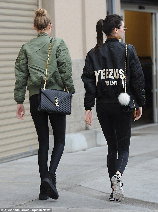 fd3cc965a18 Accessorise: Both wore black bags over their shoulders with gold chain  straps - which were by the designer YSL