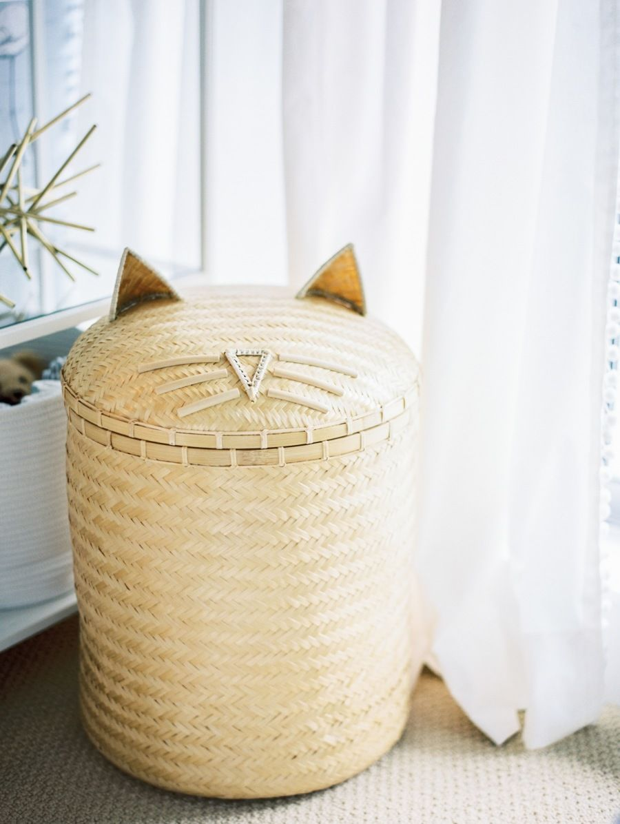 Adorable cat wicker laundry basket: Photography : Heidi Lau Read More on SMP: http://www.stylemepretty.com/living/2016/07/26/a-gender-neutral-nursery-with-the-prettiest-wallpaper-backdrop/