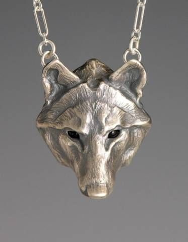 Silver Timber Wolf / plain pendant by Brooke Stone Jewelry Handcrafted Cast silver, Onyx eyes.   1 1/2 inch length