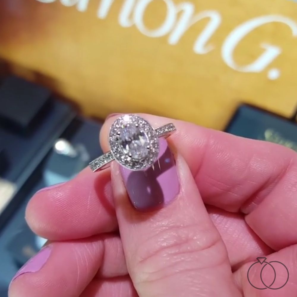 A Simon G. halo design engagement ring made for an oval diamond ...