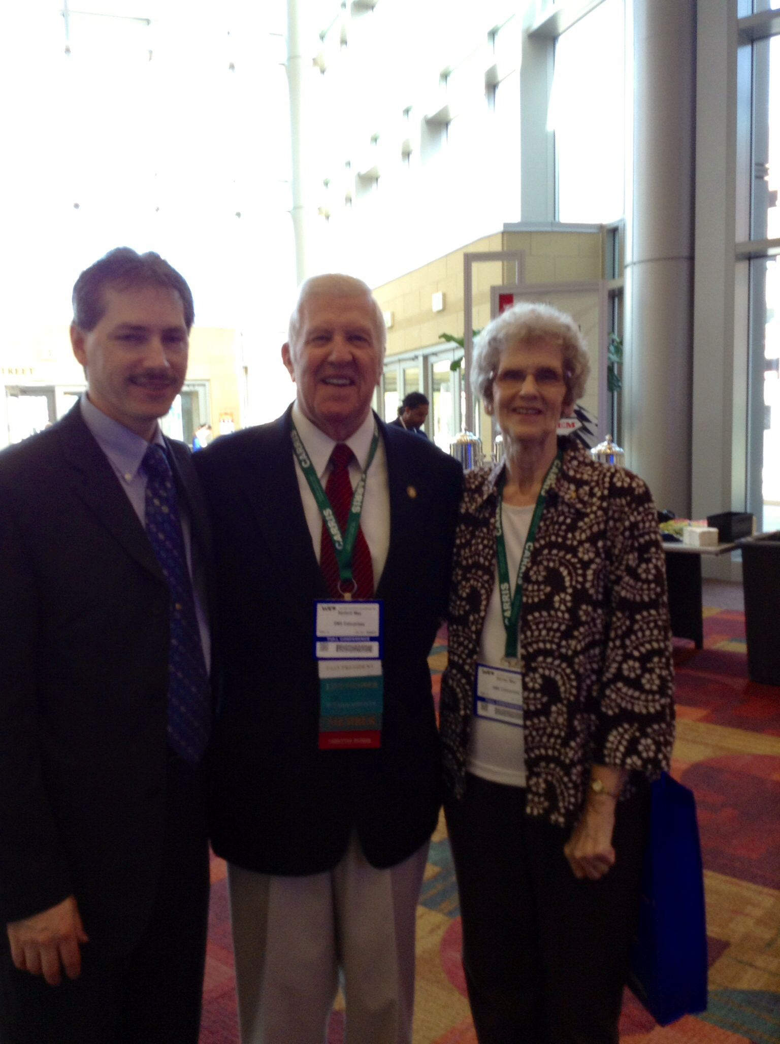 Information Tech Chuck Szymaszek with past President and Council member Sanford May and wife Shirley