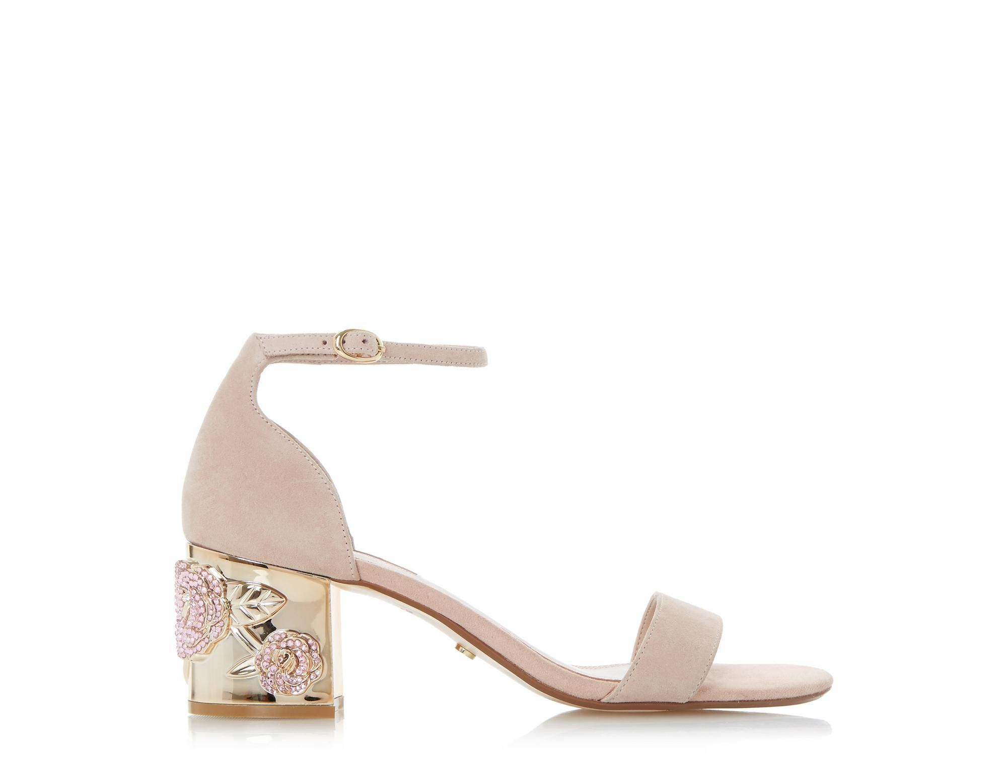 43c302115 Maygo is an exquisite two part sandal showcasing a rose embellished heel.  It features a