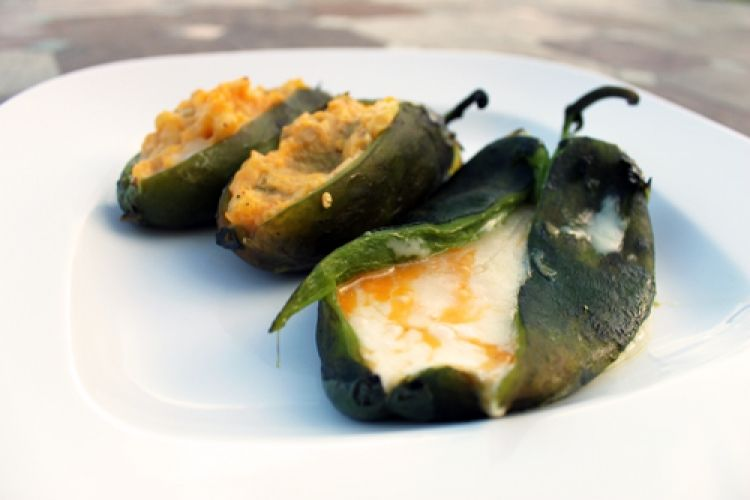 Grilled Cheese Stuffed Poblano Peppers Recipe | ChiliPepperMadness.com | You can prepare roasted stuffed poblano peppers easily on the grill with very few ingredients. Roasted peppers stand perfectly alone in flavor, but when you pair them with cheese, you're in for a special meal.