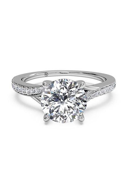 a4b4f126719 Brides.com  . Modern bypass micropavé diamond band engagement ring set in  18K white gold