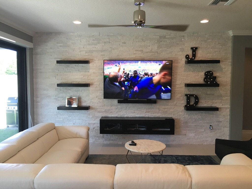 Espresso floating entertainment center and floating shelves we custom built for client