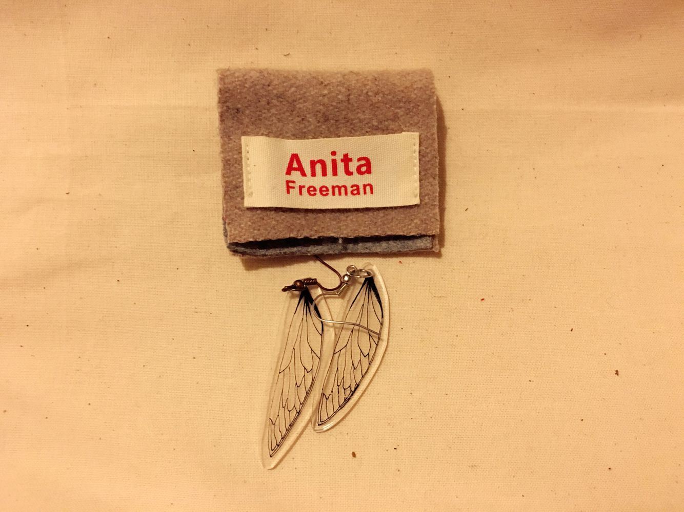 Wing earring made from a sushi box, sustainable design,handmade by Anita Freeman.