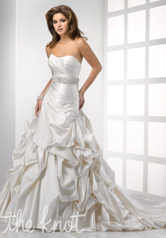 Gown features beading, brooch, corset bodice and beaded belt.