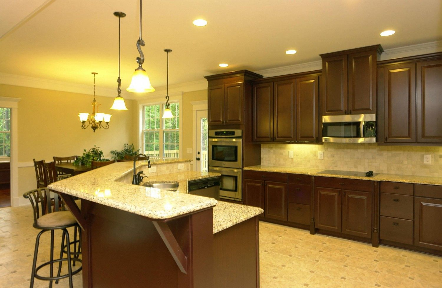 Double wall ovens. Electric cooktop. Island kitchen with raised ...