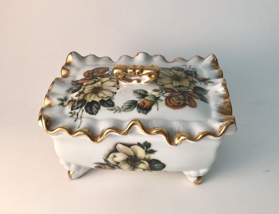and jar with lid Set of porcelain pair of candle holders Trinket box