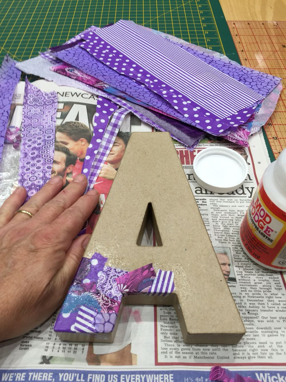 Decoupage on a cardboard 3D letter A.