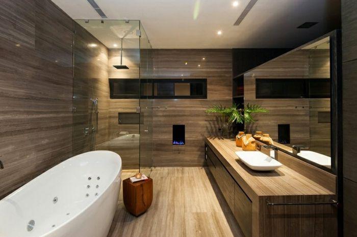 salle de bain nature, baignoire ovale blanche, sol en bois, meuble