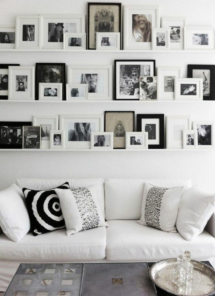 Fotowand Ideen Bilderleisten Wand dekorieren Wohnzimmer Fotos - wohnzimmer dekorieren schwarz