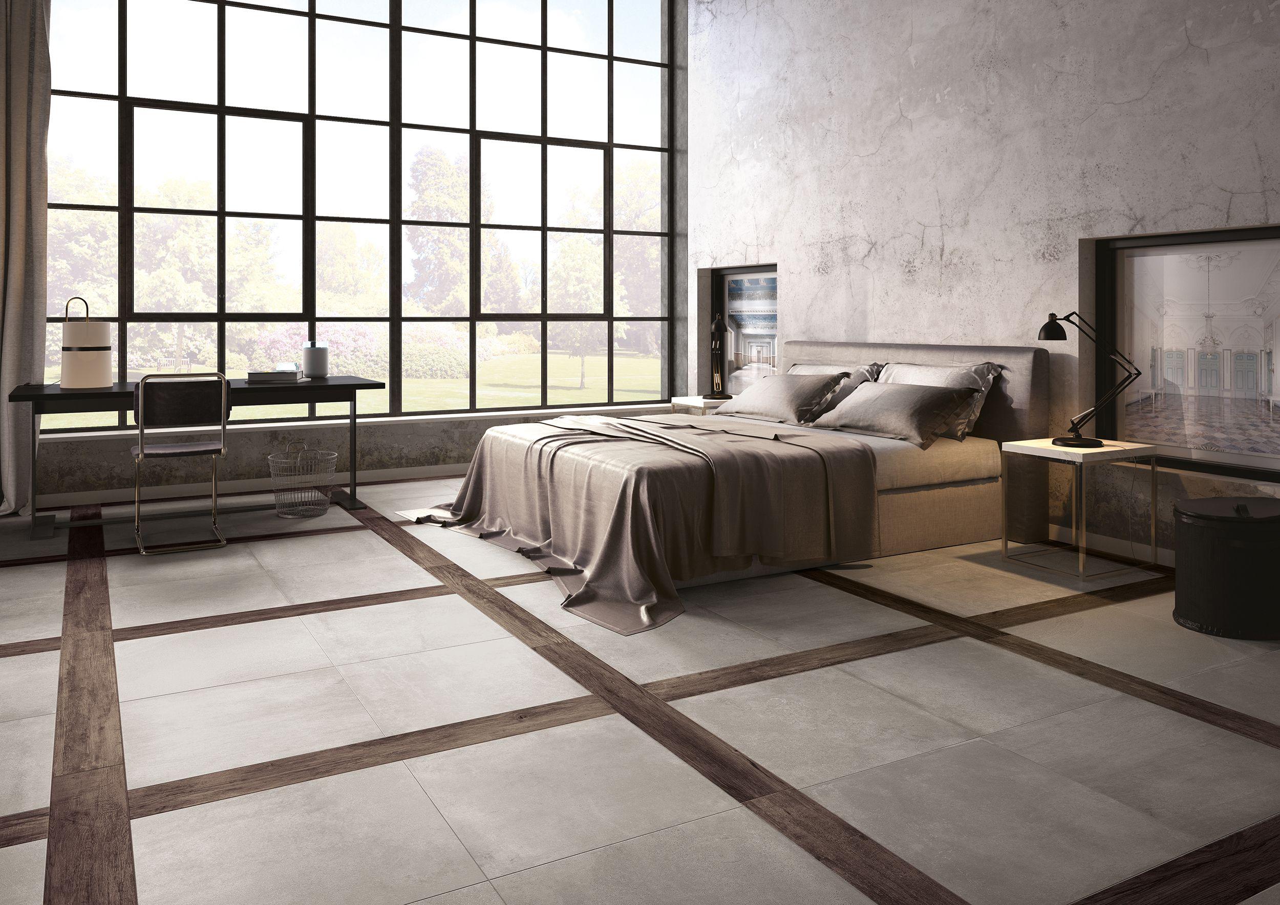 Camera da letto con piastrelle in gres porcellanato effetto cemento ...