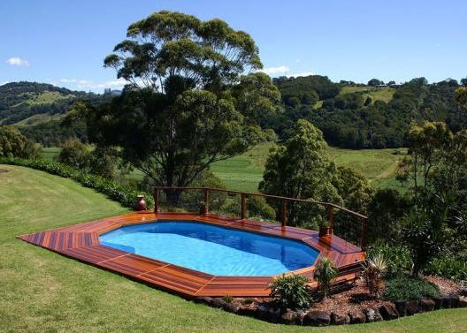 Aboveground pool set into a beautiful hillside wood deck for Pool design hillside