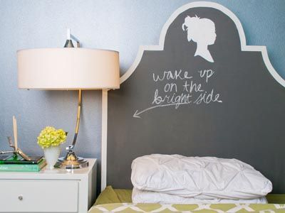 This chalkboard painted headboard from Inglenook Decor is a great